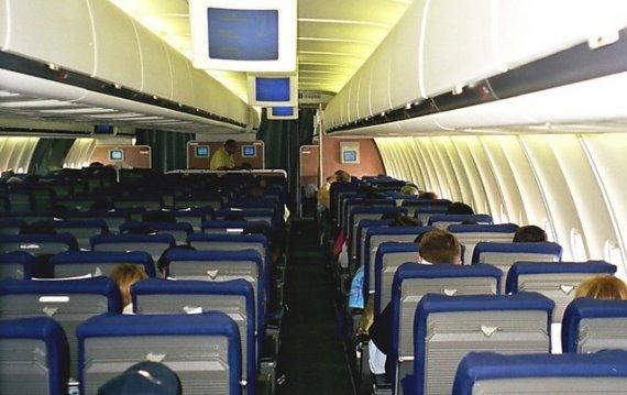 Blick in die Economy Class Kabine einer MD-11 der Swissair, Symbolbild - Foto: Philippe Gindrat