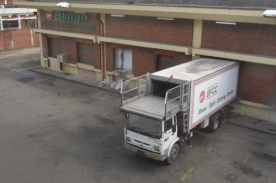 A Biman Airlines catering truck on the rear side of the building, in which the delicious meals for the passenger's pleasure are prepared