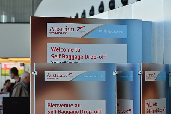 AUA Austrian Airlines Self Baggage Drop off Hinweisschilder Foto PA Austrian Wings Media Crew